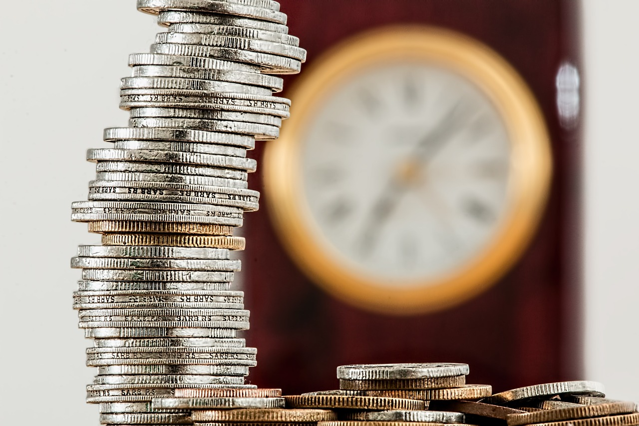 Stack of coins and clock
